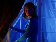 The Night Sitter Trailer Is A Neon-Drenched Nightmare